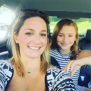 April Goff, Senior Accountant, with her daughter.